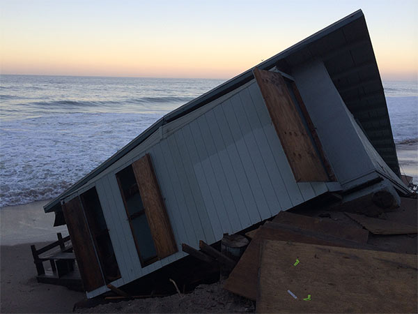 A State Parks administrative lifeguard building collapsed into the ocean at Point Mugu State Park on Wednesday, Aug. 27, 2014. <span class=meta>Surf damage</span>