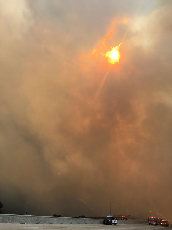<div class='meta'><div class='origin-logo' data-origin='none'></div><span class='caption-text' data-credit=''>Large clouds of smoke cover the sky from a fire between Sun Valley and Tujunga on Friday, Sept. 1, 2017.</span></div>