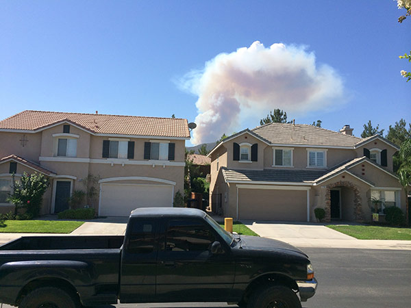 """<div class=""""meta image-caption""""><div class=""""origin-logo origin-image """"><span></span></div><span class=""""caption-text"""">Smoke from a brush fire in Silverado Canyon is seen from Corona in this photo from an ABC7 viewer on Friday, Sept. 12, 2014. (ABC7 viewer )</span></div>"""