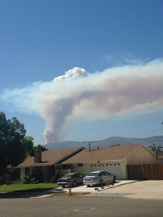 """<div class=""""meta image-caption""""><div class=""""origin-logo origin-image """"><span></span></div><span class=""""caption-text"""">Smoke from a brush fire in Silverado Canyon is seen in this photo from an ABC7 viewer on Friday, Sept. 12, 2014. (ABC7 viewer )</span></div>"""
