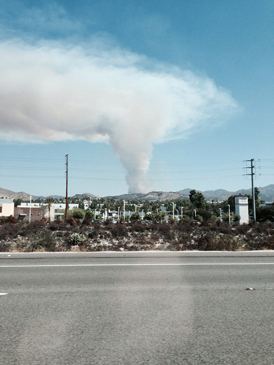 """<div class=""""meta image-caption""""><div class=""""origin-logo origin-image """"><span></span></div><span class=""""caption-text"""">Smoke from a brush fire in Silverado Canyon is seen from State Route 241 toll road in Foothill Ranch in this photo from an ABC7 viewer on Friday, Sept. 12, 2014. (ABC7 viewer )</span></div>"""
