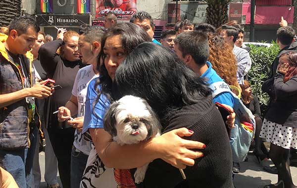 <div class='meta'><div class='origin-logo' data-origin='AP'></div><span class='caption-text' data-credit='AP Photo/Eduardo Verdugo'>Women embrace in the street after an earthquake in Mexico City, Tuesday, Sept. 19, 2017.</span></div>