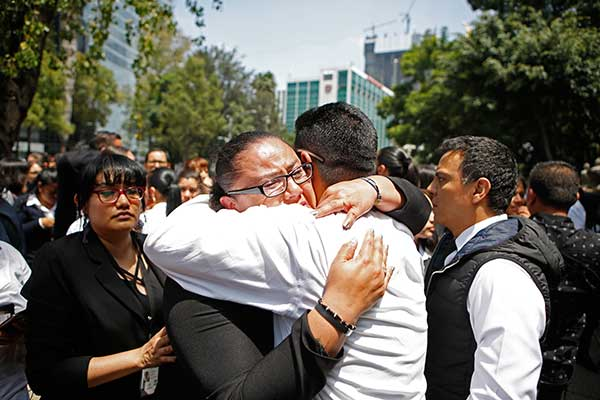 <div class='meta'><div class='origin-logo' data-origin='AP'></div><span class='caption-text' data-credit='AP Photo/Eduardo Verdugo'>A woman is comforted after an earthquake in Mexico City Tuesday Sept. 19, 2017.</span></div>