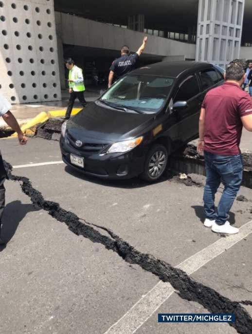 <div class='meta'><div class='origin-logo' data-origin='none'></div><span class='caption-text' data-credit='Twitter/michglez'>A cracked road is seen in the aftermath of a powerful earthquake to hit Mexico on Tuesday, Sept. 19, 2017.</span></div>
