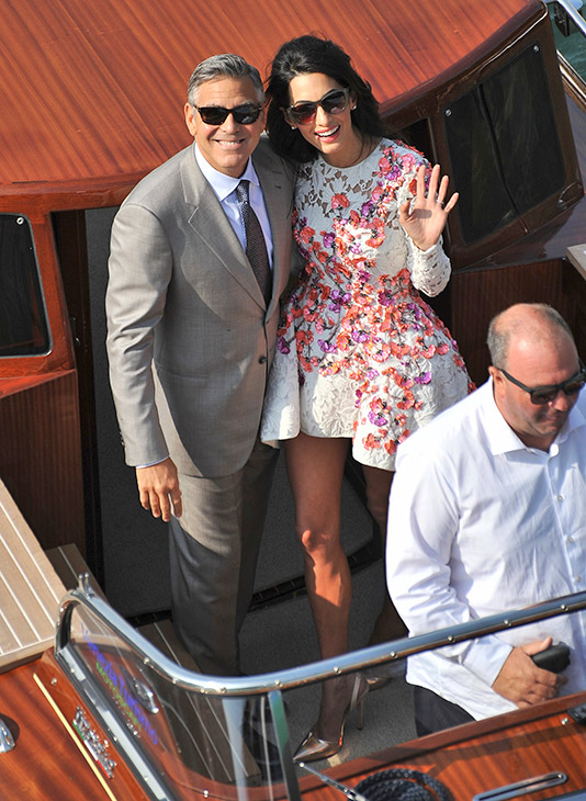 """<div class=""""meta image-caption""""><div class=""""origin-logo origin-image """"><span></span></div><span class=""""caption-text"""">George Clooney and his wife Amal Alamuddin, cruise the Grand Canal after leaving the Aman luxury Hotel in Venice, Italy, Sunday, Sept. 28, 2014. (AP Photo/Luigi Costantini)</span></div>"""