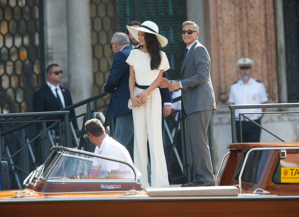 """<div class=""""meta image-caption""""><div class=""""origin-logo origin-image """"><span></span></div><span class=""""caption-text"""">George Clooney, flanked by his wife Amal Alamuddin, arrives at the Cavalli Palace for their civil marriage ceremony in Venice, Italy, Monday, Sept. 29, 2014.  (AP Photo/Luca Bruno)</span></div>"""