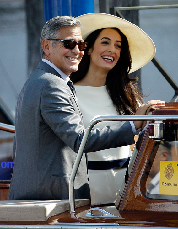"""<div class=""""meta image-caption""""><div class=""""origin-logo origin-image """"><span></span></div><span class=""""caption-text"""">George Clooney and Amal Alamuddin leave the Cipriani hotel for their civil marriage ceremony at the Cavalli Palace in Venice, Italy, Monday, Sept. 29, 2014. (AP Photo/Andrew Medichini)</span></div>"""
