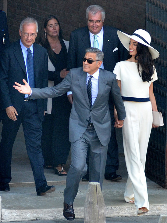 """<div class=""""meta image-caption""""><div class=""""origin-logo origin-image """"><span></span></div><span class=""""caption-text"""">George Clooney and his wife Amal Alamuddin leave the city hall after their civil marriage ceremony performed by Rome's former mayor Walter Veltroni, left, in Venice, Italy. (AP Photo/Luigi Costantini)</span></div>"""