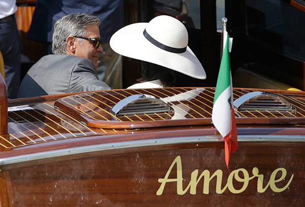 """<div class=""""meta image-caption""""><div class=""""origin-logo origin-image """"><span></span></div><span class=""""caption-text"""">George Clooney and his wife Amal Alamuddin leave Venice's city hall after their civil marriage ceremony on Monday, Sept. 29, 2014. (AP Photo/Andrew Medichini)</span></div>"""