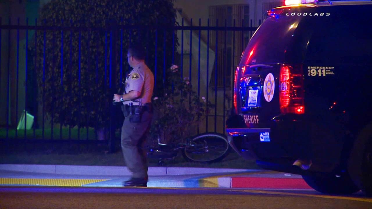 Police investigate the shooting death of a man found near his bicycle early Saturday, Sept. 26, 2015.