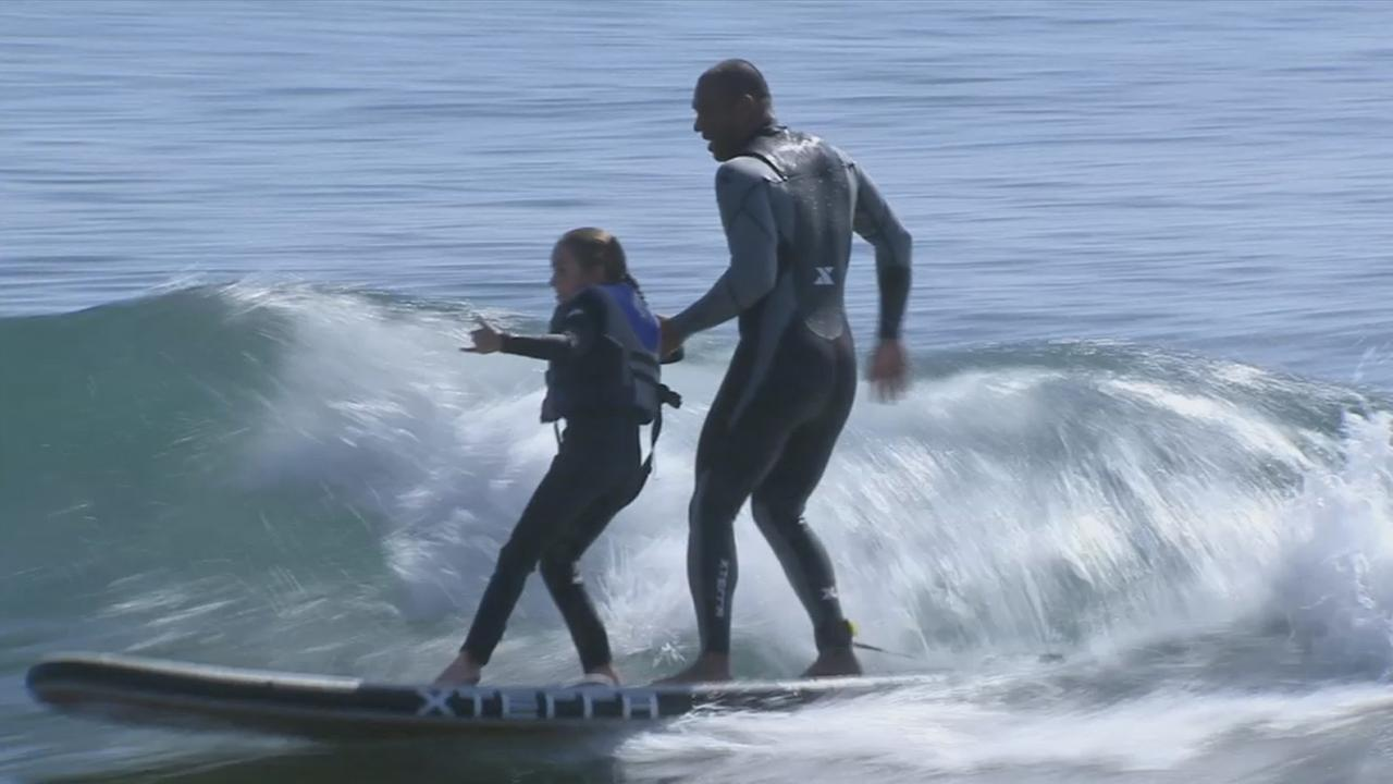 Surfing help kids with cystic fibrosis overcome difficulties