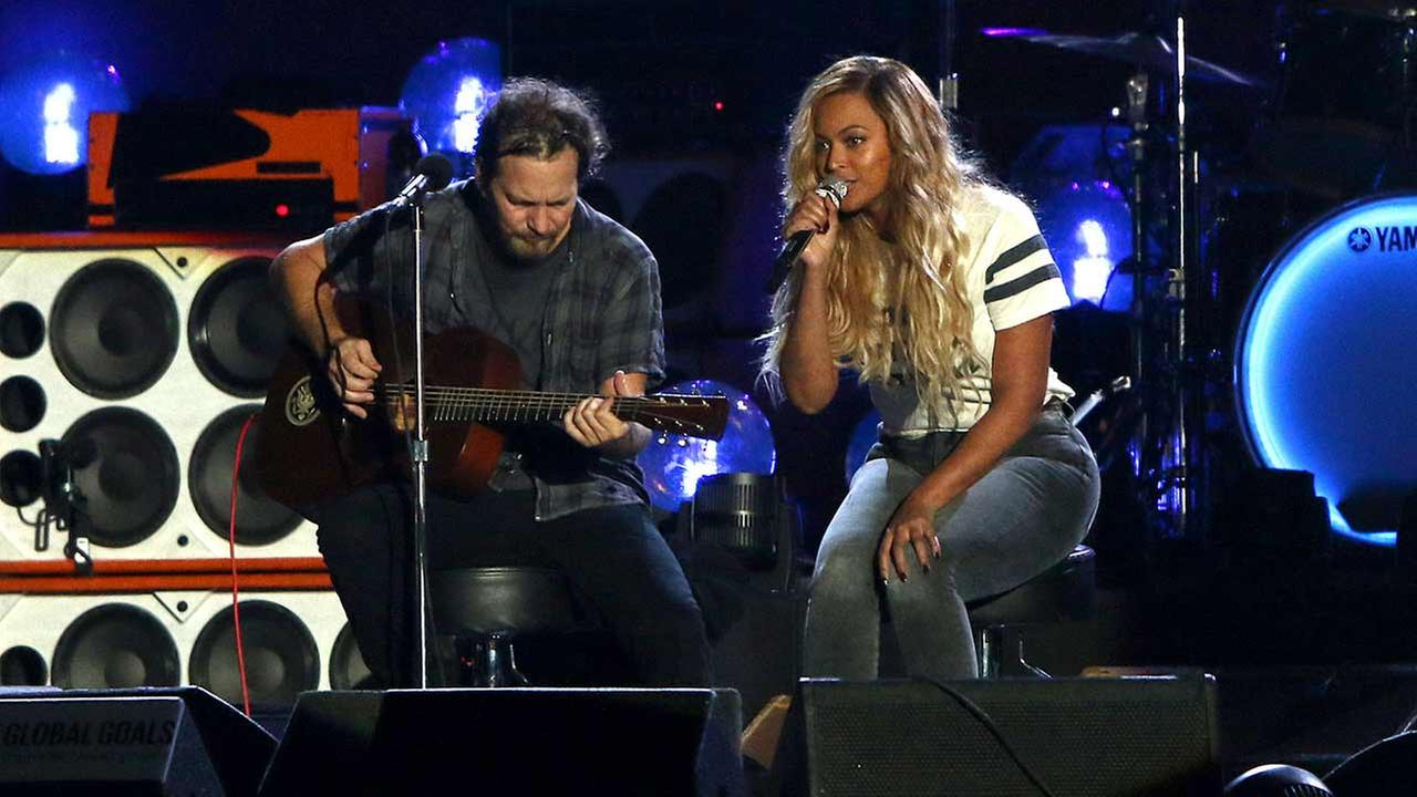 Eddie Vedder, left, and Beyonce perform at the Global Citizen Festival in Central Park on Saturday, Sept. 26, 2015, in New York.