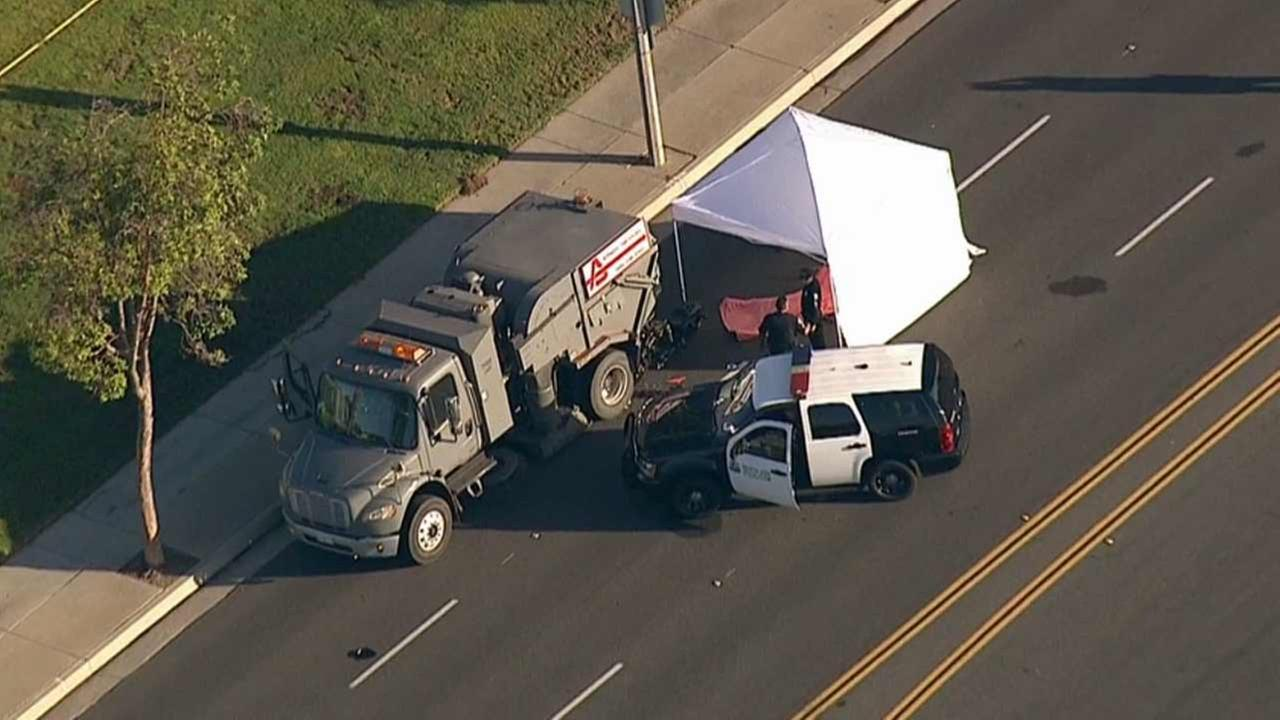 Santa Ana police investigate a fatal collision involving a street sweeper near the intersection of Red Hill and Warner avenues on Thursday, Oct. 1, 2015.