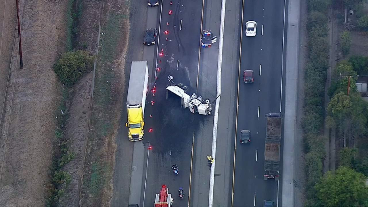 An overturned truck spilled tar all over the road on the 71 Freeway, shutting all southbound lanes during the morning commute on Friday, Oct. 2, 2015.