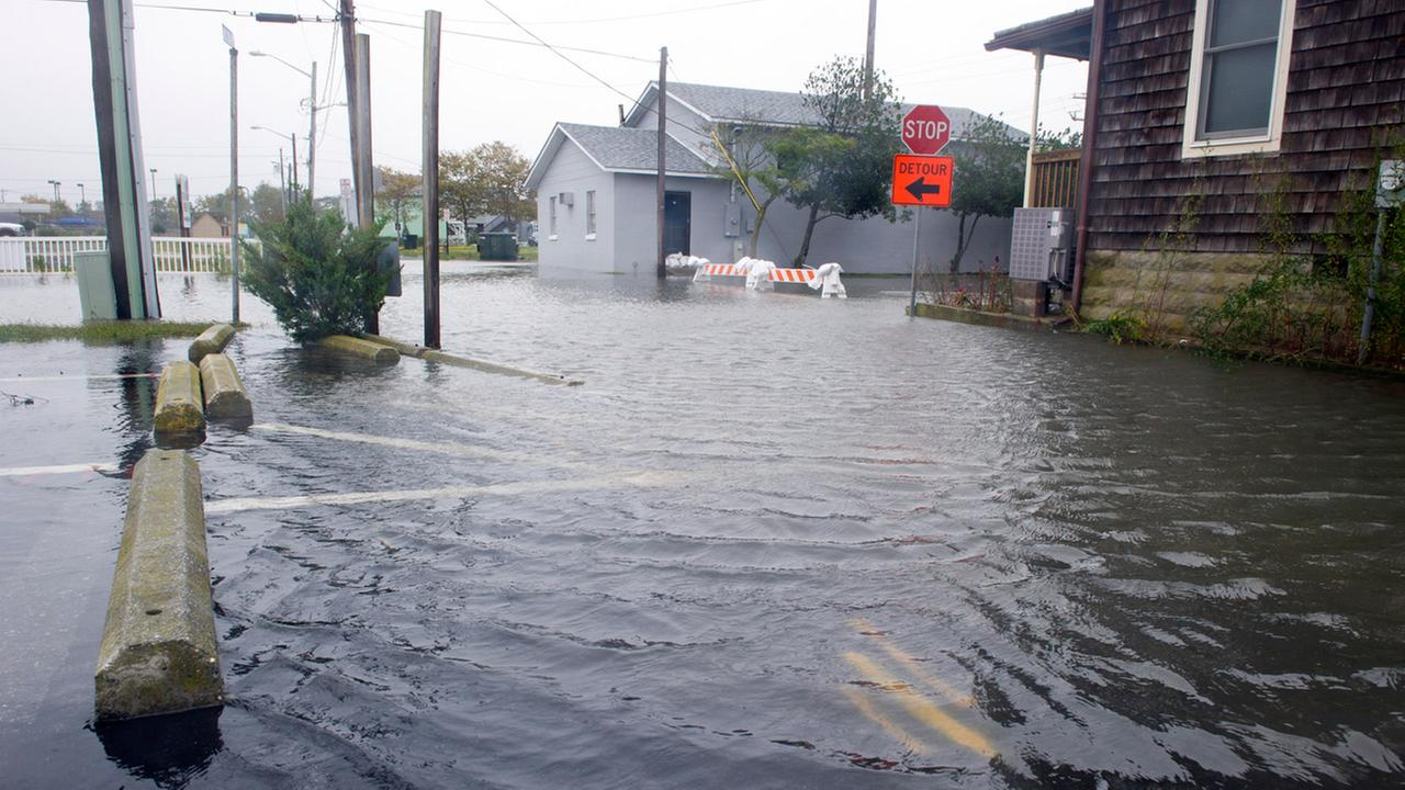 High-tide floods roads and parking lot in downtown Ocean City, Md., Saturday, Oct. 3, 2015.