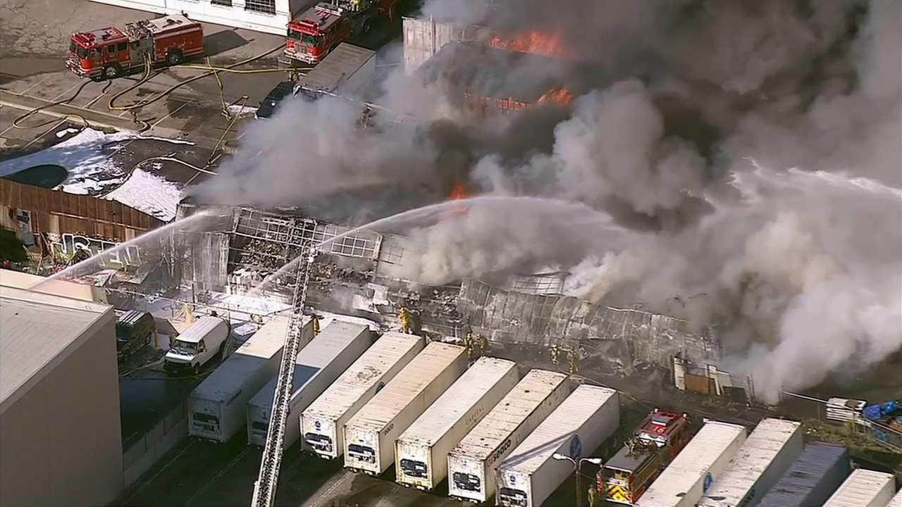 LA County firefighters are battling a blaze that erupted at a Huntington Park commercial building Monday, Oct. 5, 2015.