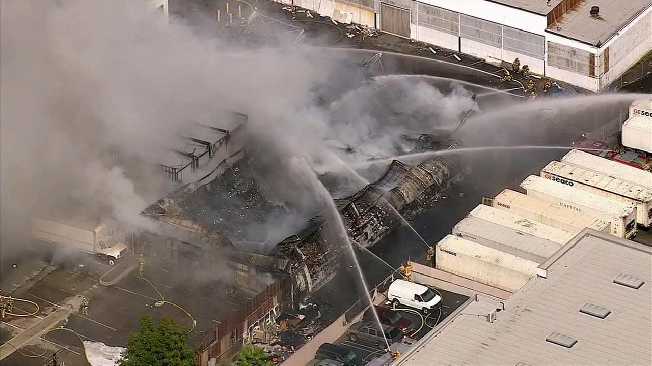 LA County firefighters battle a blaze that erupted at a Huntington Park commercial building Monday, Oct. 5, 2015.