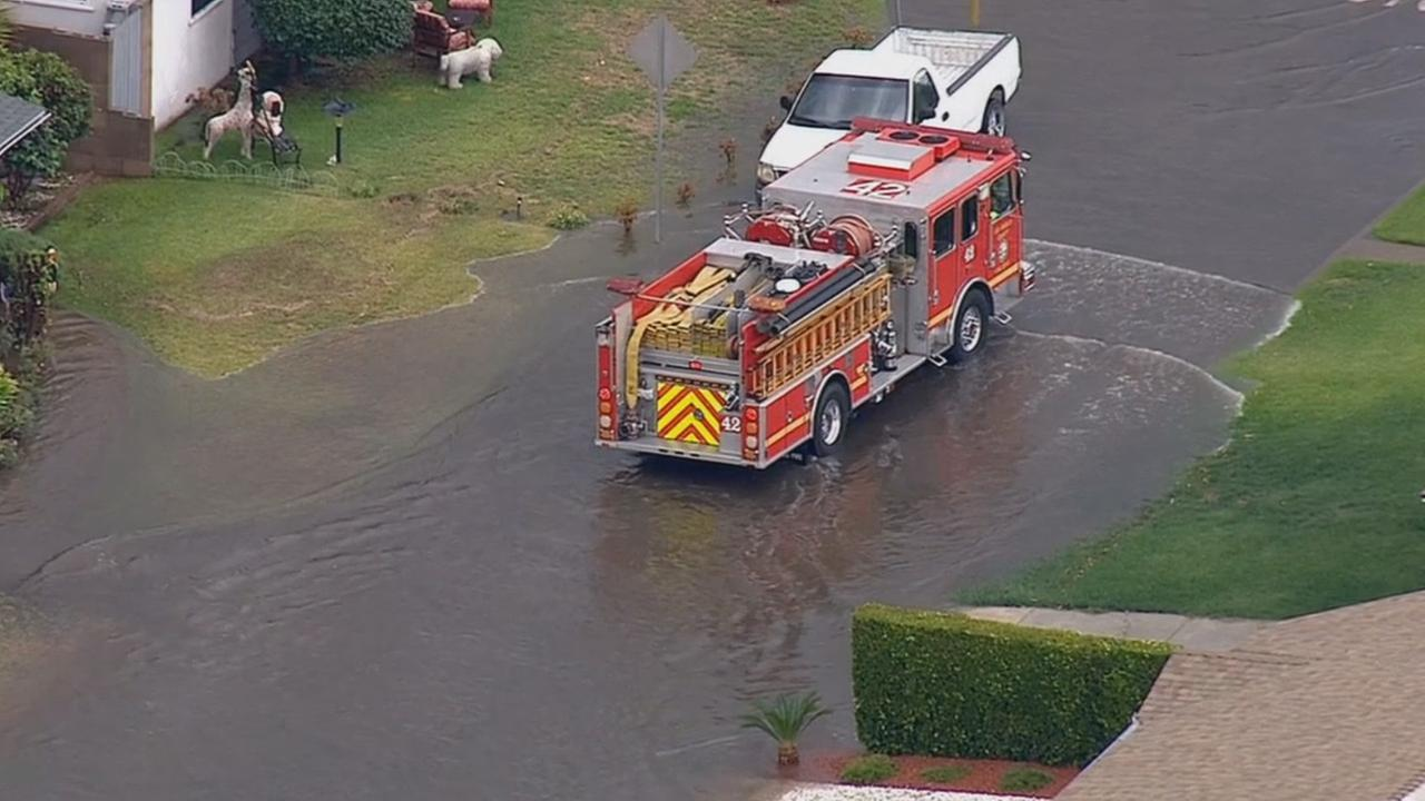 A fire truck is seen in the middle of a flooded street in Temple City on Monday, Oct. 5, 2015.