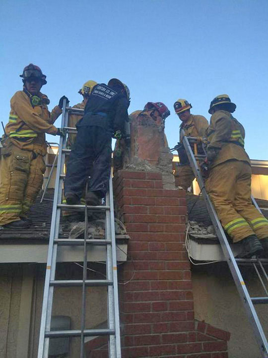 <div class='meta'><div class='origin-logo' data-origin='none'></div><span class='caption-text' data-credit='VCFD Capt. Mike Lindbery, Twitter.com/VCFD_PIO'>USAR members work to free a woman from a chimney in Thousand Oaks on Sunday, Oct. 19, 2014.</span></div>