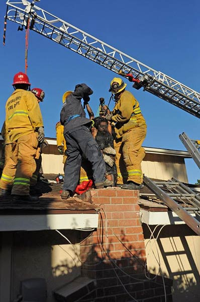 <div class='meta'><div class='origin-logo' data-origin='none'></div><span class='caption-text' data-credit='VCFD Capt. Mike Lindbery, Twitter.com/VCFD_PIO'>USAR members hoist a woman from a chimney in Thousand Oaks on Sunday, Oct. 19, 2014.</span></div>