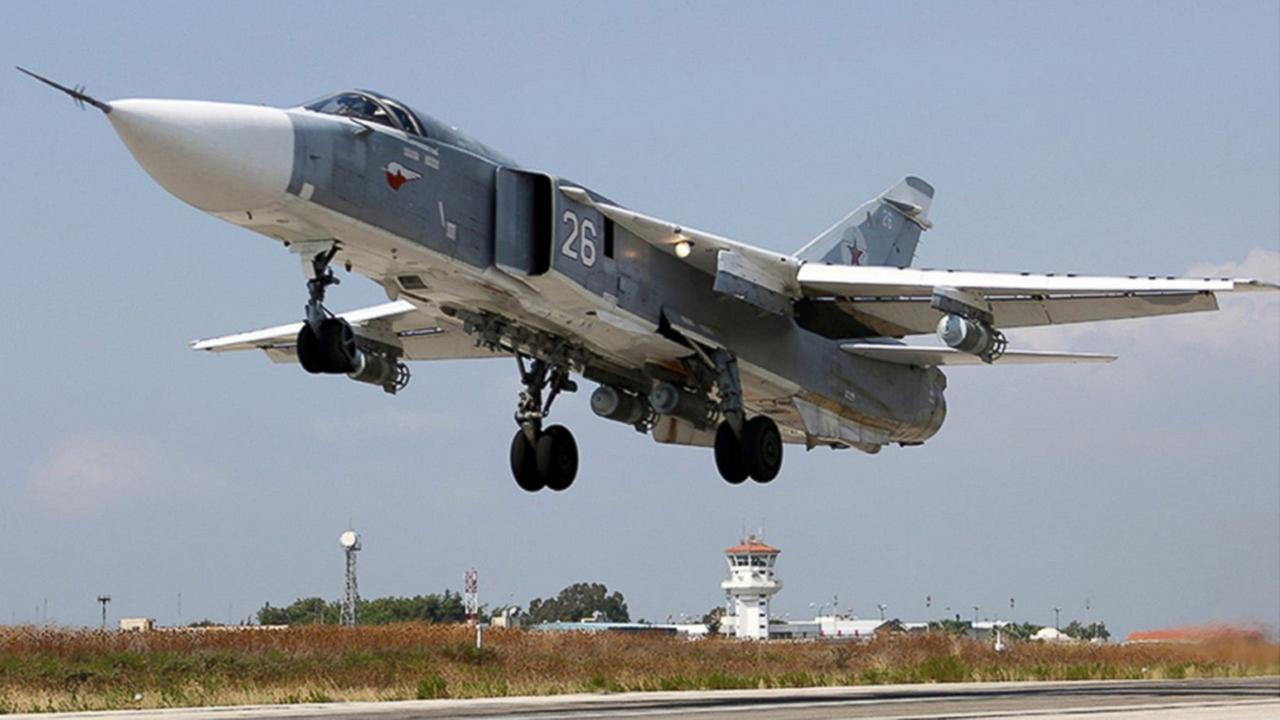 In this photo taken from Russian Defense Ministry official web site on Tuesday, Oct. 6, 2015, a Russian SU-24M jet fighter takes off from an airbase Hmeimim in Syria.