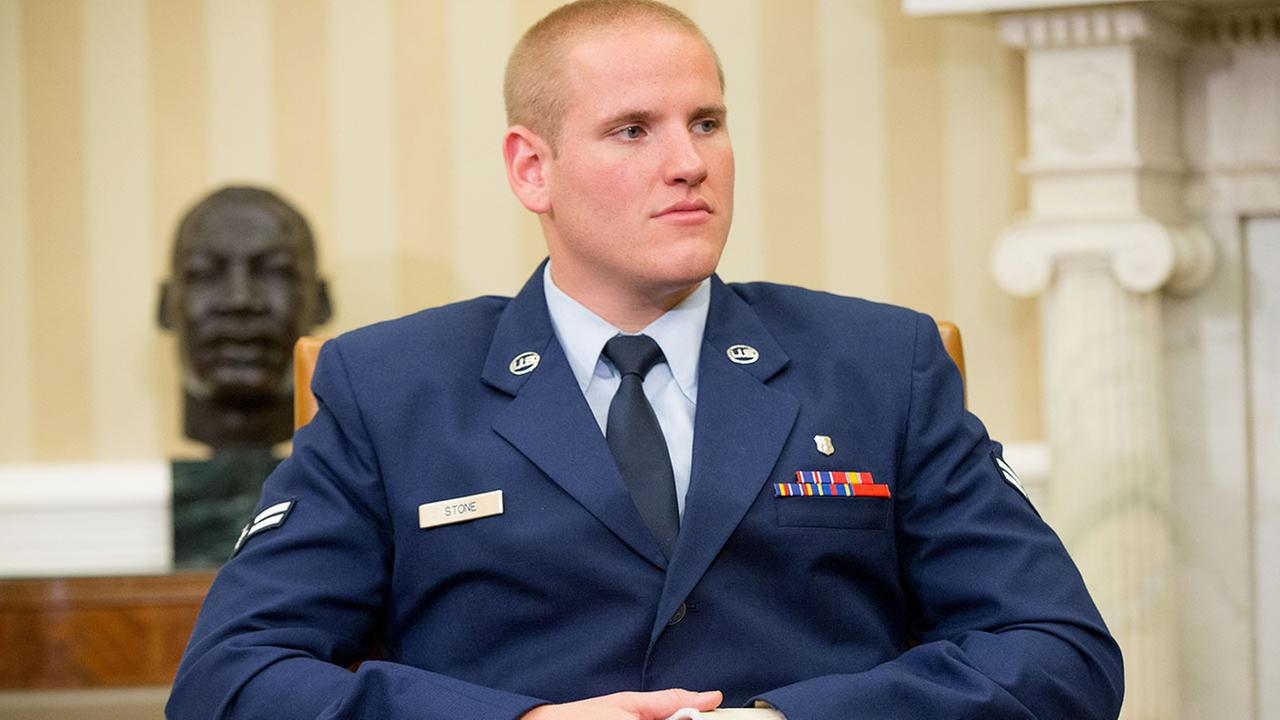 The injured hand of Air Force Airman 1st Class Spencer Stone can be seen as he and Oregon National Guardsman Alek Skarlatos and Anthony Sadler meet with President Barack Obama in the Oval Office of the White House in Washington, Thursday, Sept. 17, 2015,