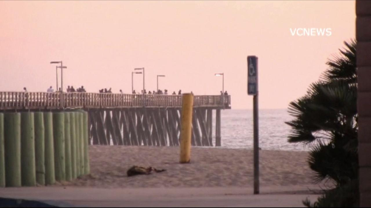 Groups watched six people being rescued near the Port Hueneme Pier on Sunday, Oct. 11, 2015.