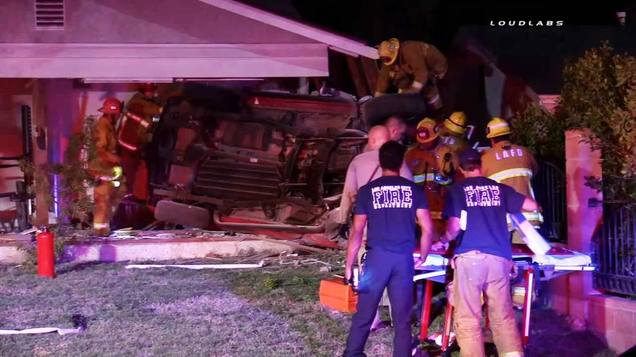 A vehicle slammed into a home in Granada Hills on Tuesday, Oct. 13, 2015.