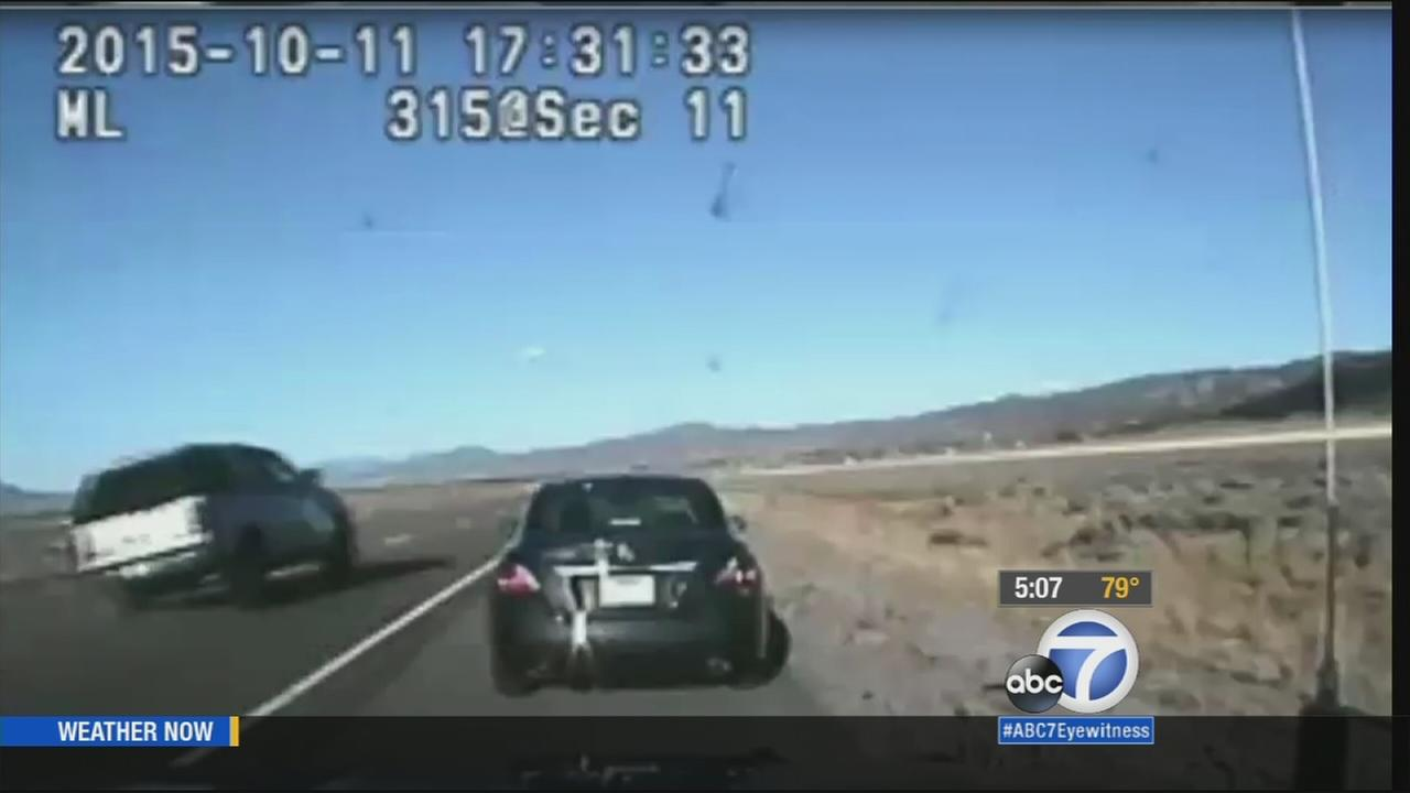 An alleged distracted driver in Utah nearly hit a state trooper who was conducting a traffic stop before rolling her vehicle over several times.