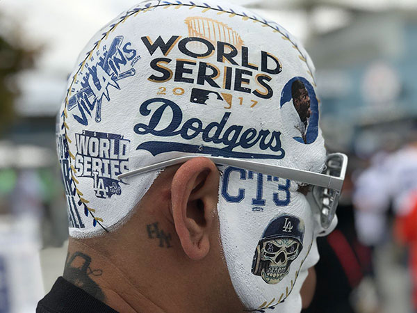 <div class='meta'><div class='origin-logo' data-origin='KABC'></div><span class='caption-text' data-credit='Curt Sandoval/KABC'>This fan is ready to head into Game 6 of the World Series.</span></div>