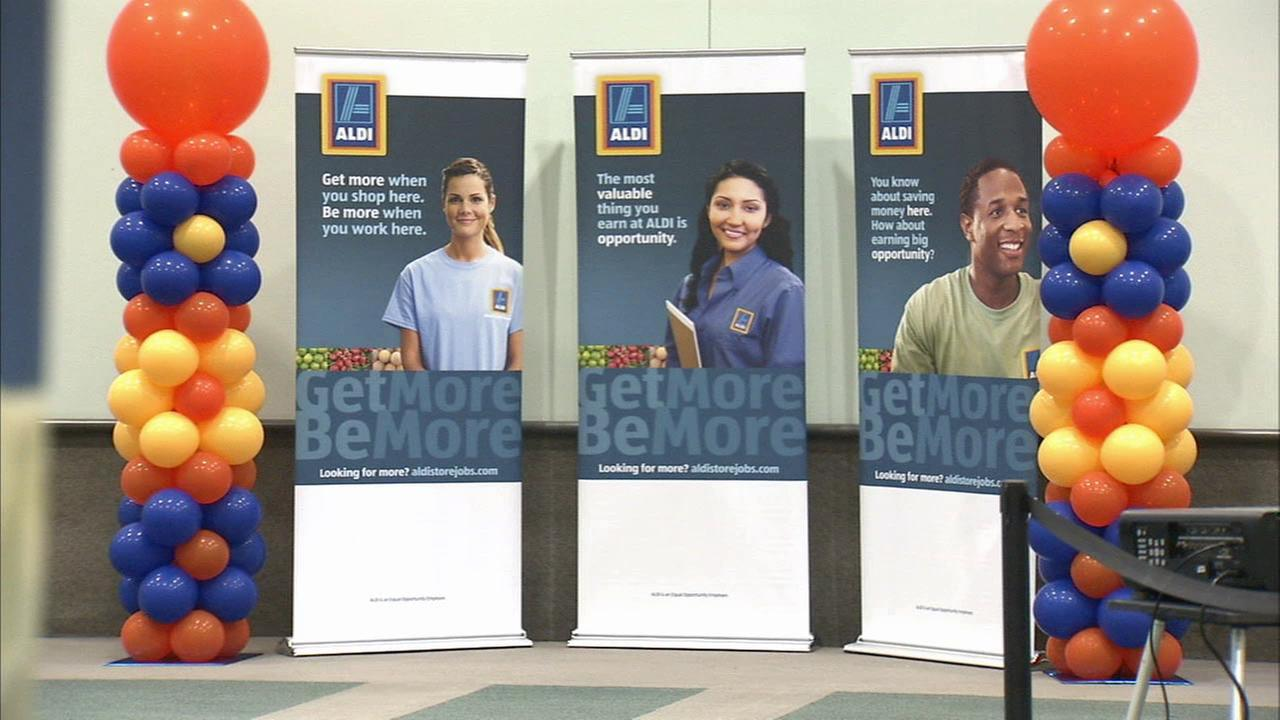 Signs for Aldi are shown at the Los Angeles Convention Center on Friday, Oct. 16, 2015.