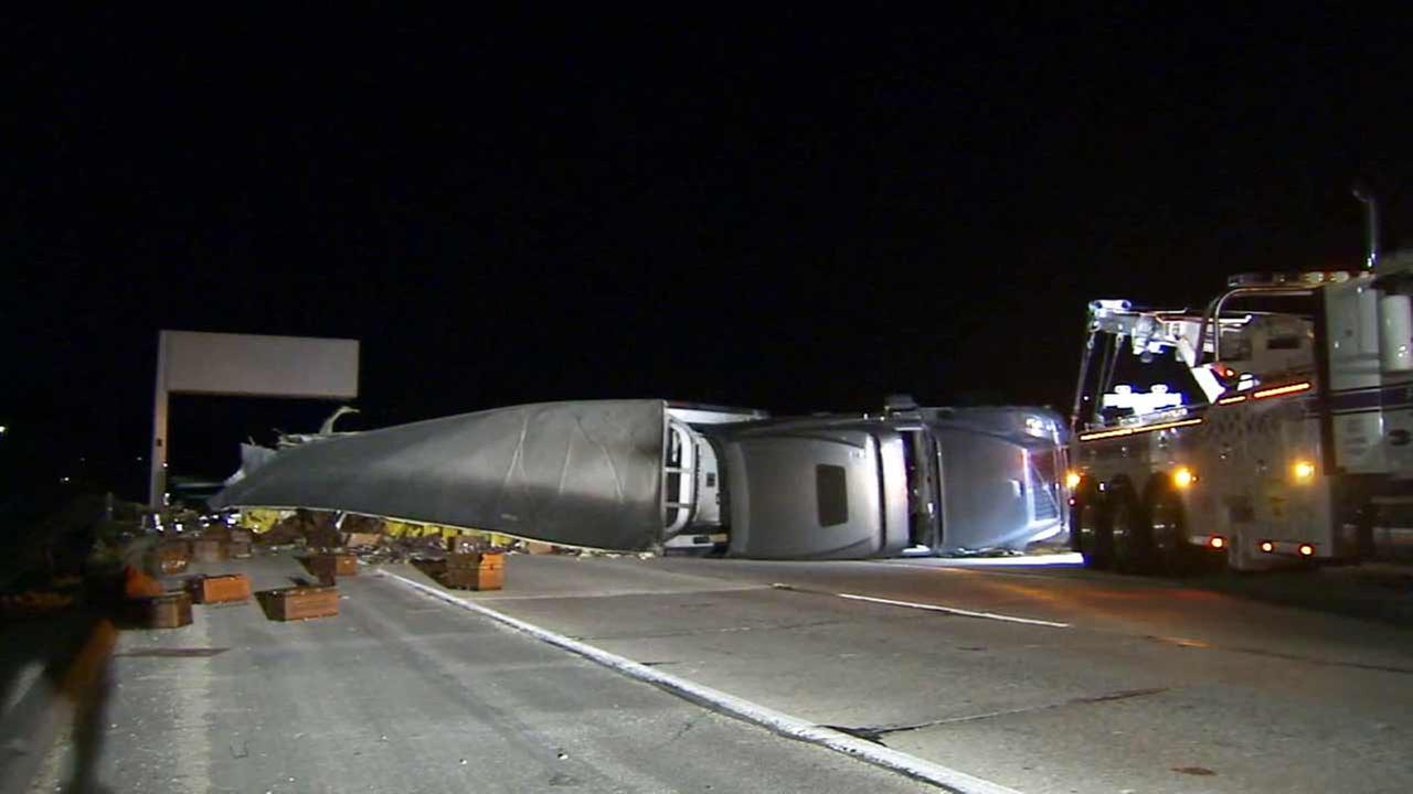 California Highway Patrol officials respond to the scene of a big rig crash on the eastbound 210 Freeway in La Canada Flintridge on Wednesday, Oct. 21, 2015.
