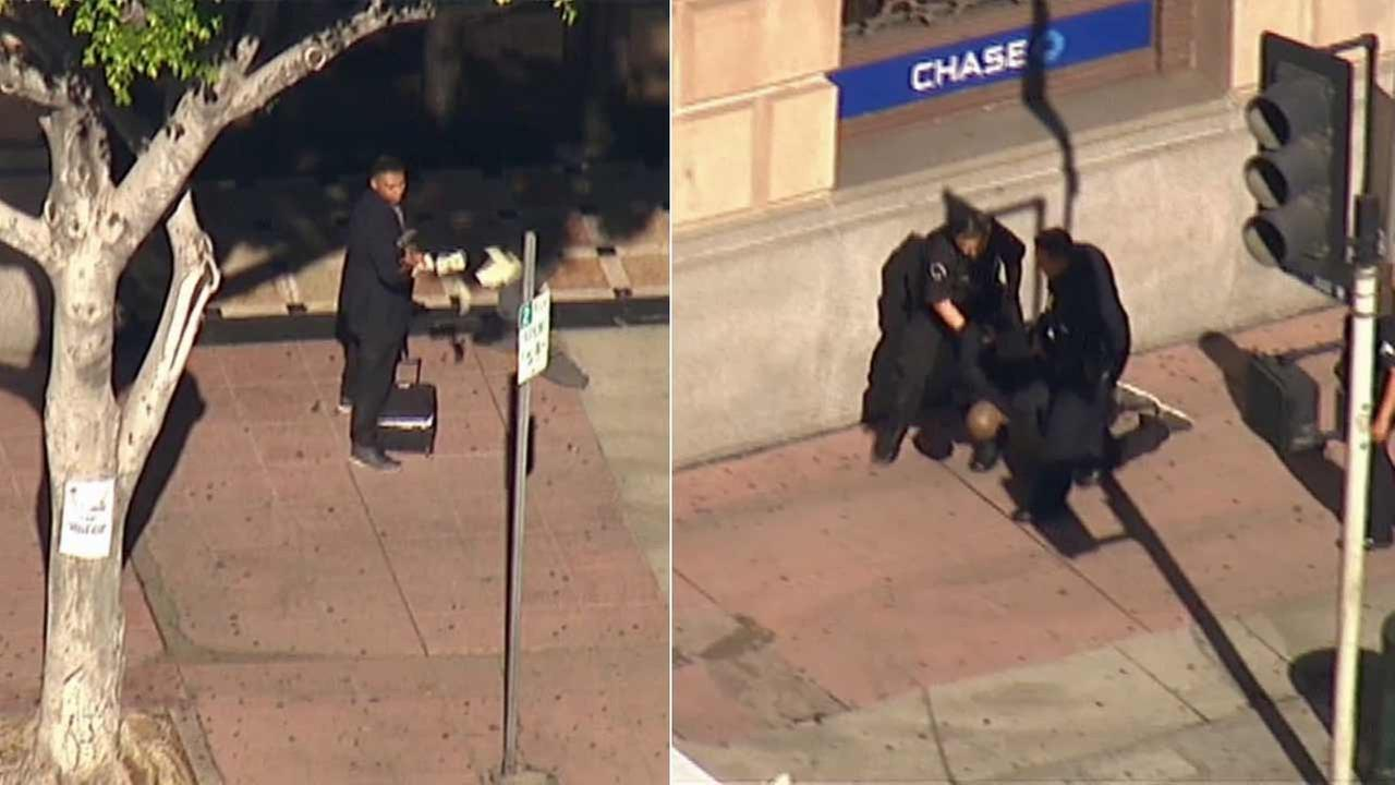 An alleged bank robbery suspect was arrested outside a Chase Bank near W. 9th and S. Hill streets in downtown Los Angeles on Monday, Oct. 26, 2015.