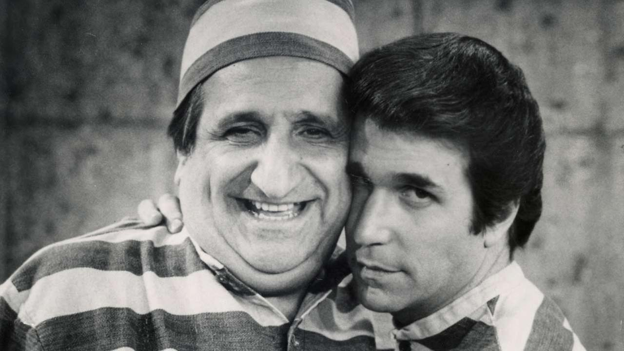In this photo provided by ABC in 1981, Al Molinaro, left, and Henry Winkler pose in character in an episode from Happy Days.ABC via AP