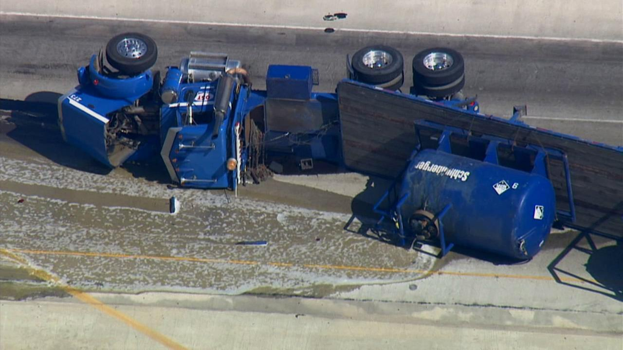 An overturned tanker shut down northbound lanes of the 5 Freeway at the 126 in Santa Clarita on Tuesday, June 10, 2014.