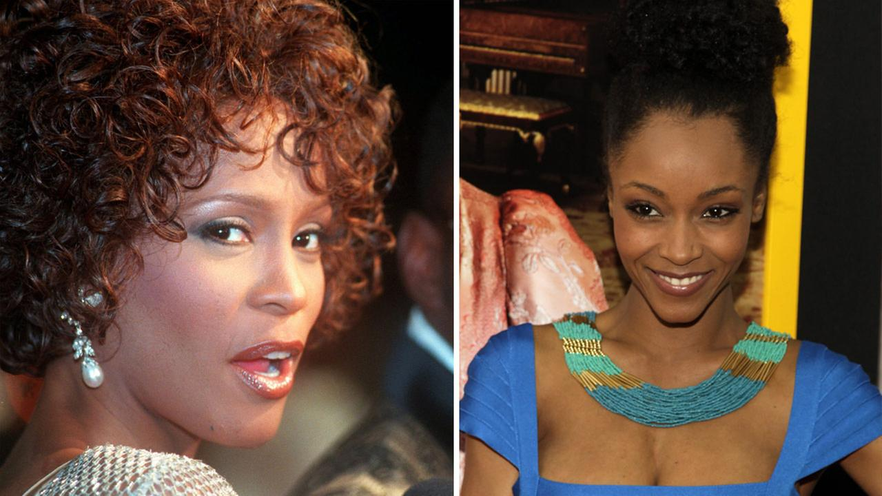 Whitney Houston at the premiere of The Wonderful World of Disney movie Cinderella on Oct. 13, 1997. / Yaya DaCosta attends the New York premiere of Belle on April 28, 2014.