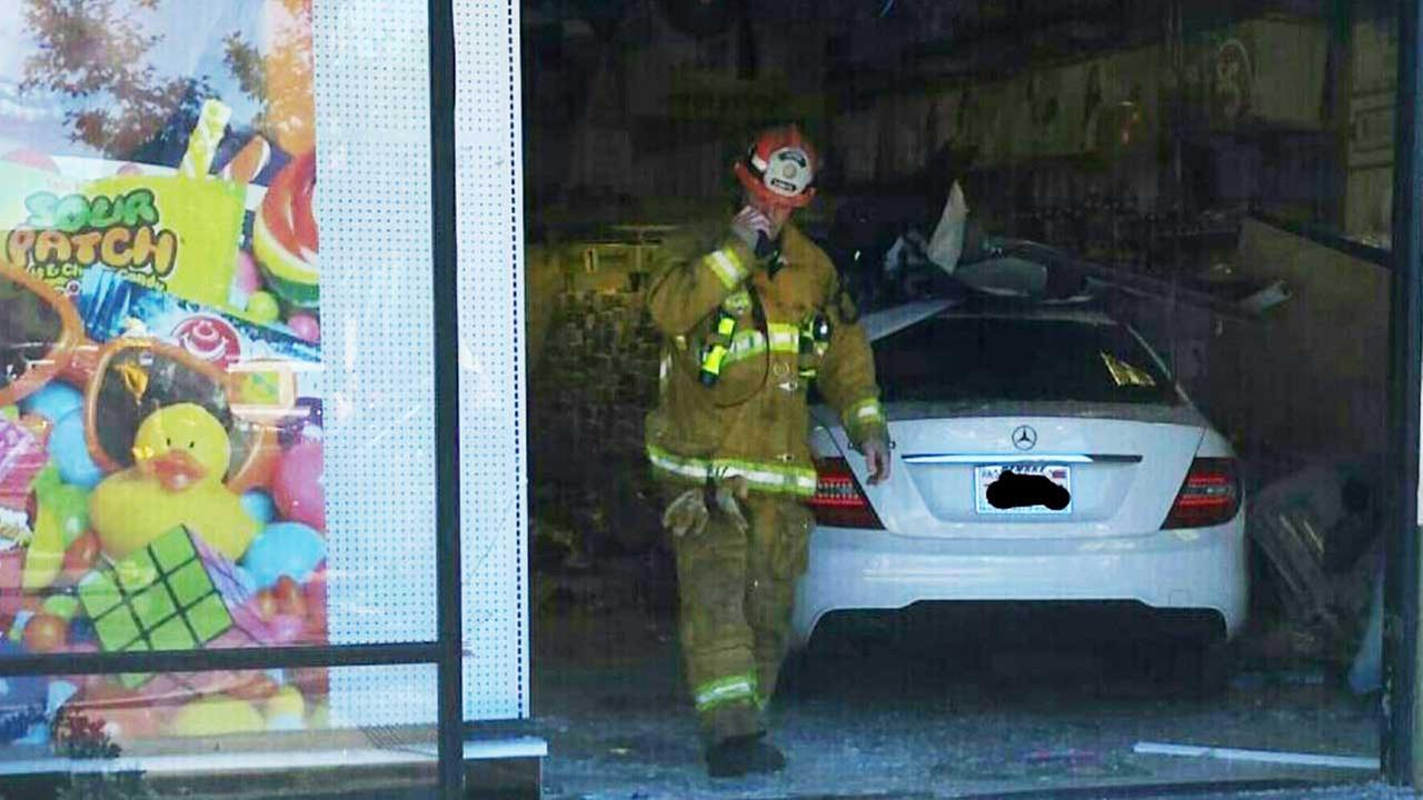 Firefighters respond to an incident involving a vehicle that plowed into a San Dimas Party City store on Halloween, Saturday, Oct. 31, 2015.