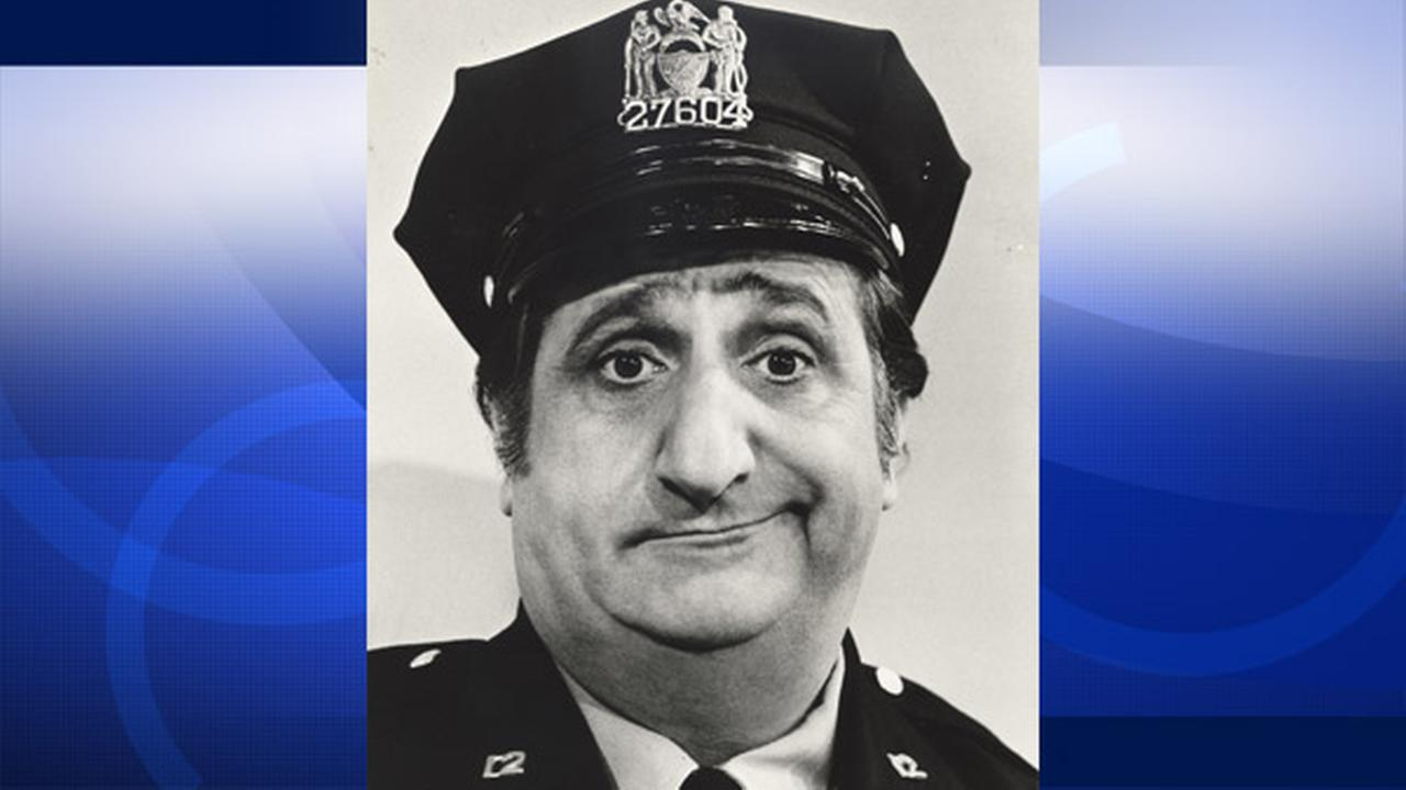 In a photo, provided in 1974 by ABC, actor Al Molinaro poses dressed as Murray the cop. He died of complications of gallstone problems at age 96 Friday, Oct. 30, 2015.
