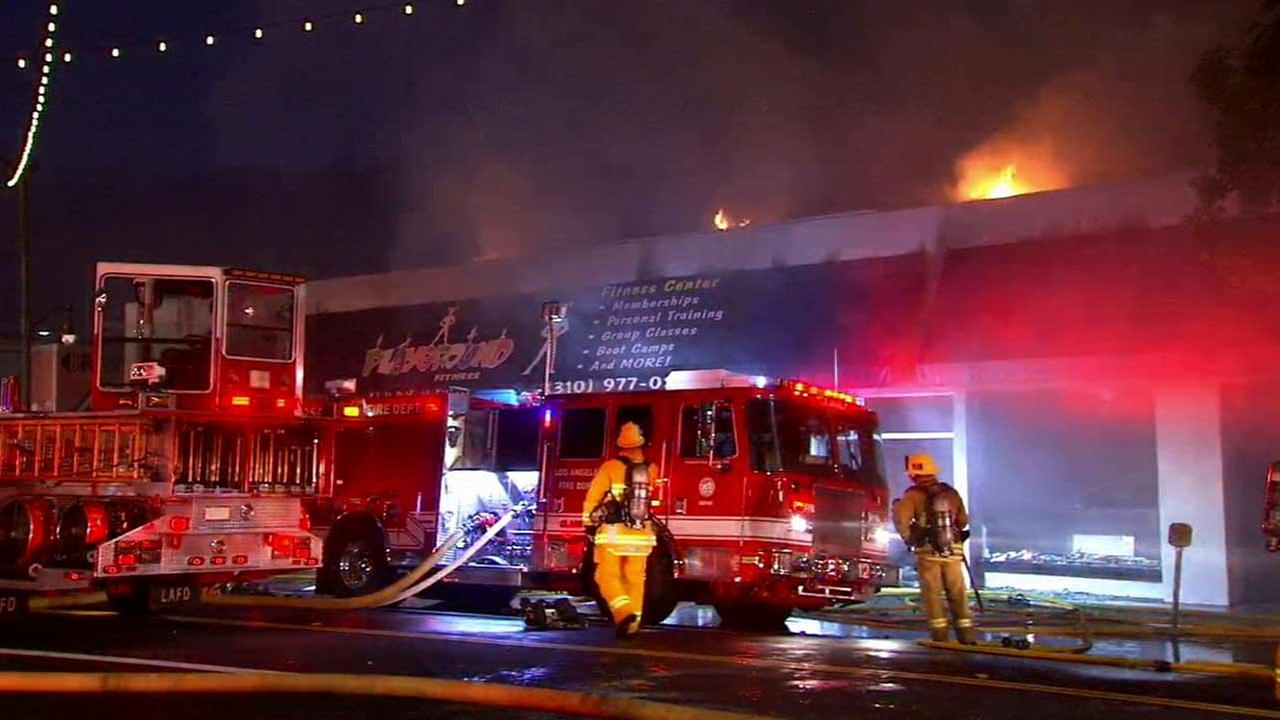 Los Angeles firefighters respond to a fire at a one-story commercial building in the 500 block of S. Pacific Avenue in San Pedro on Monday, Nov. 2, 2015.