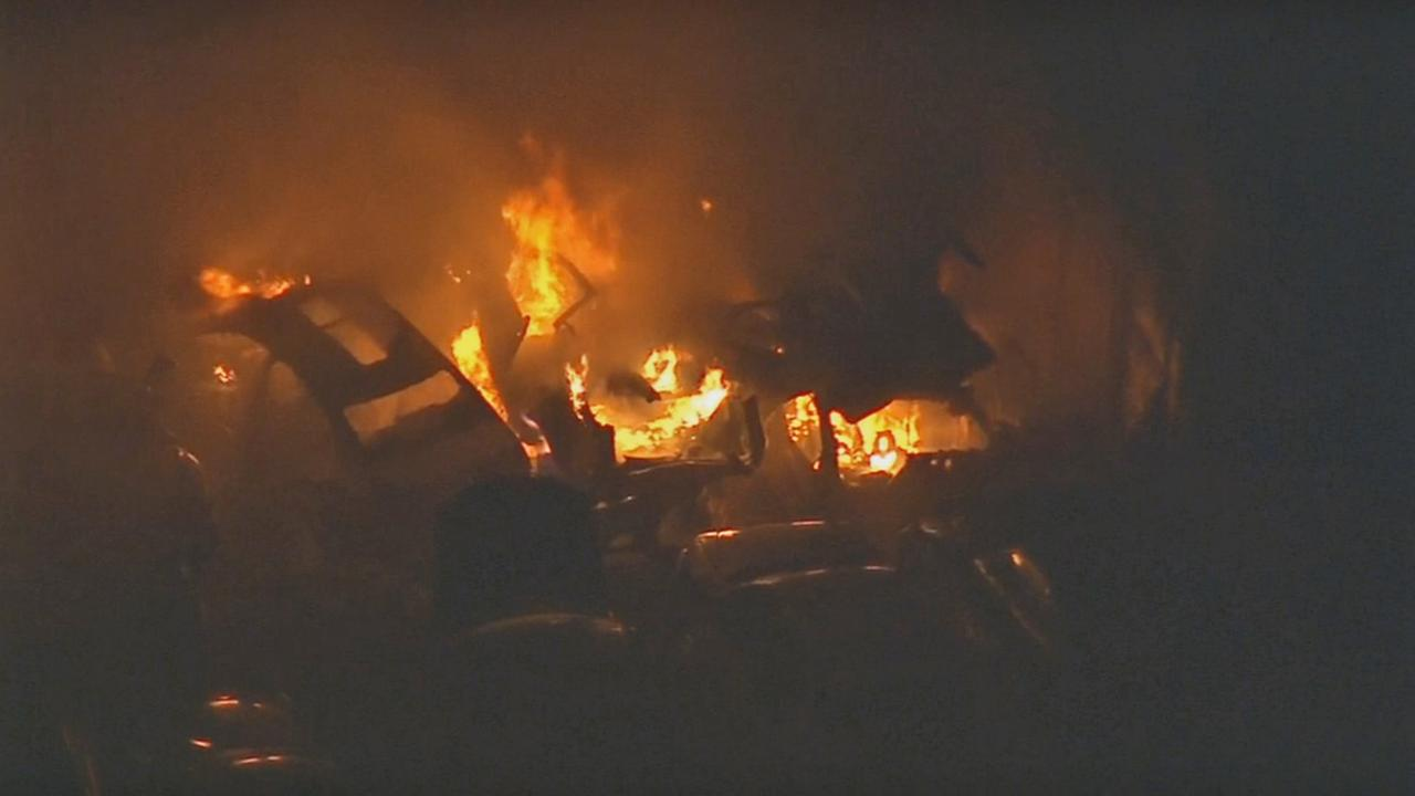 Flames burn several vehicles at a junkyard in the 2400 block of Citrus View Avenue near Monrovia on Monday, Nov. 2, 2015.