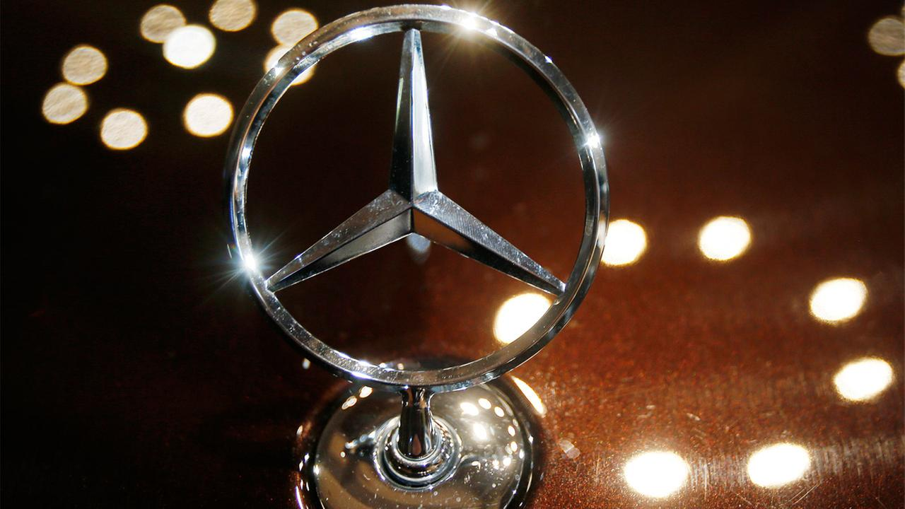 In this Feb. 5, 2015 file photo the logo of a Mercedes car is photographed during an annual press conference of Daimler AG in Stuttgart, Germany.