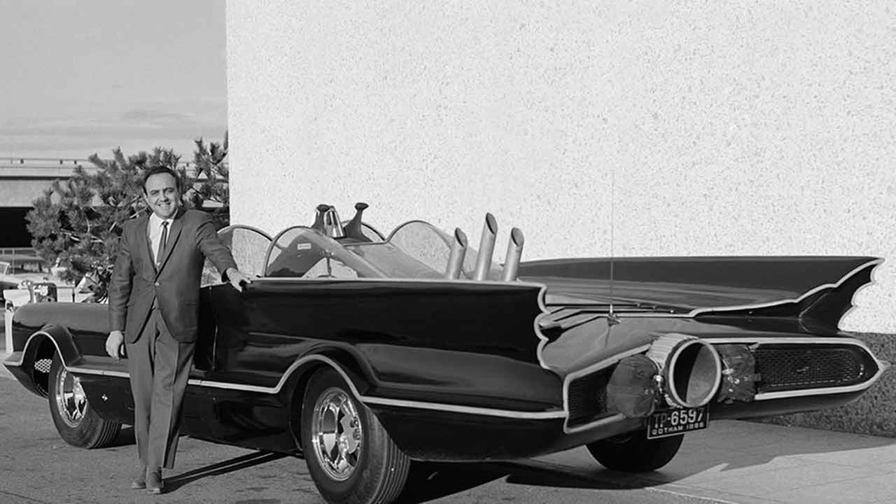 This 1966 photo provided by Lozzi Media Services and Barris Kustom Industries shows designer George Barris with the original Batmobile in Los Angeles.Lozzi Media Services/Barris Kustom Industries via AP