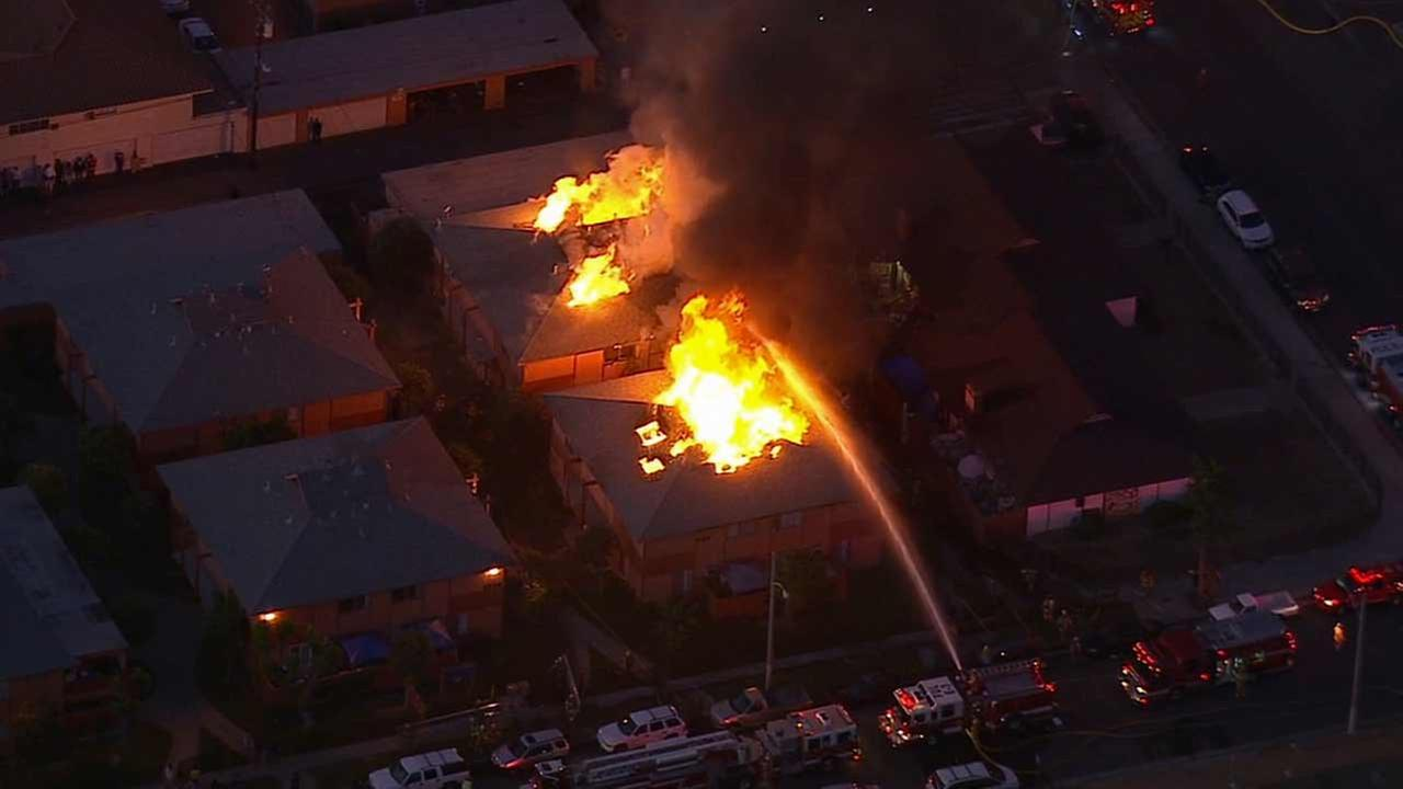 Two apartment buildings erupted in flames in the 1500 block of E. Benmore Lane in Anaheim on Friday, Nov. 6, 2015.