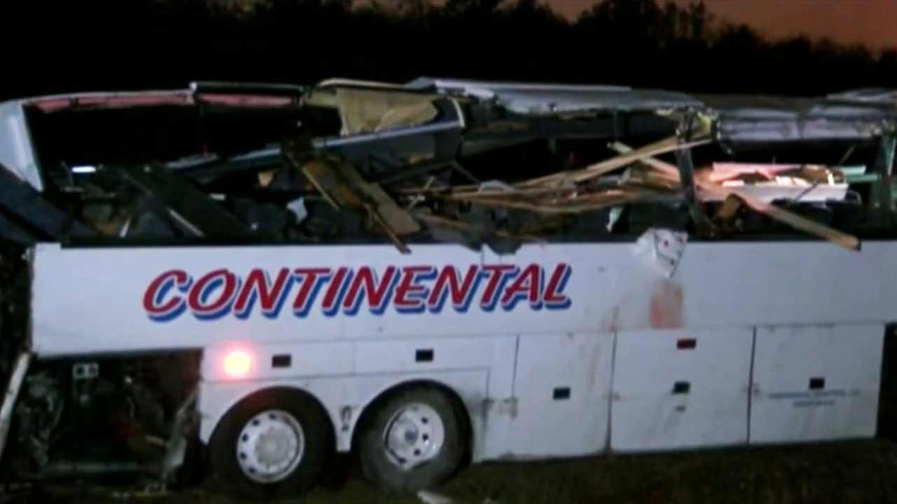 Arkansas State Police investigate a charter bus crash that left six people dead off Interstate 40 on Friday, Nov. 6, 2015.