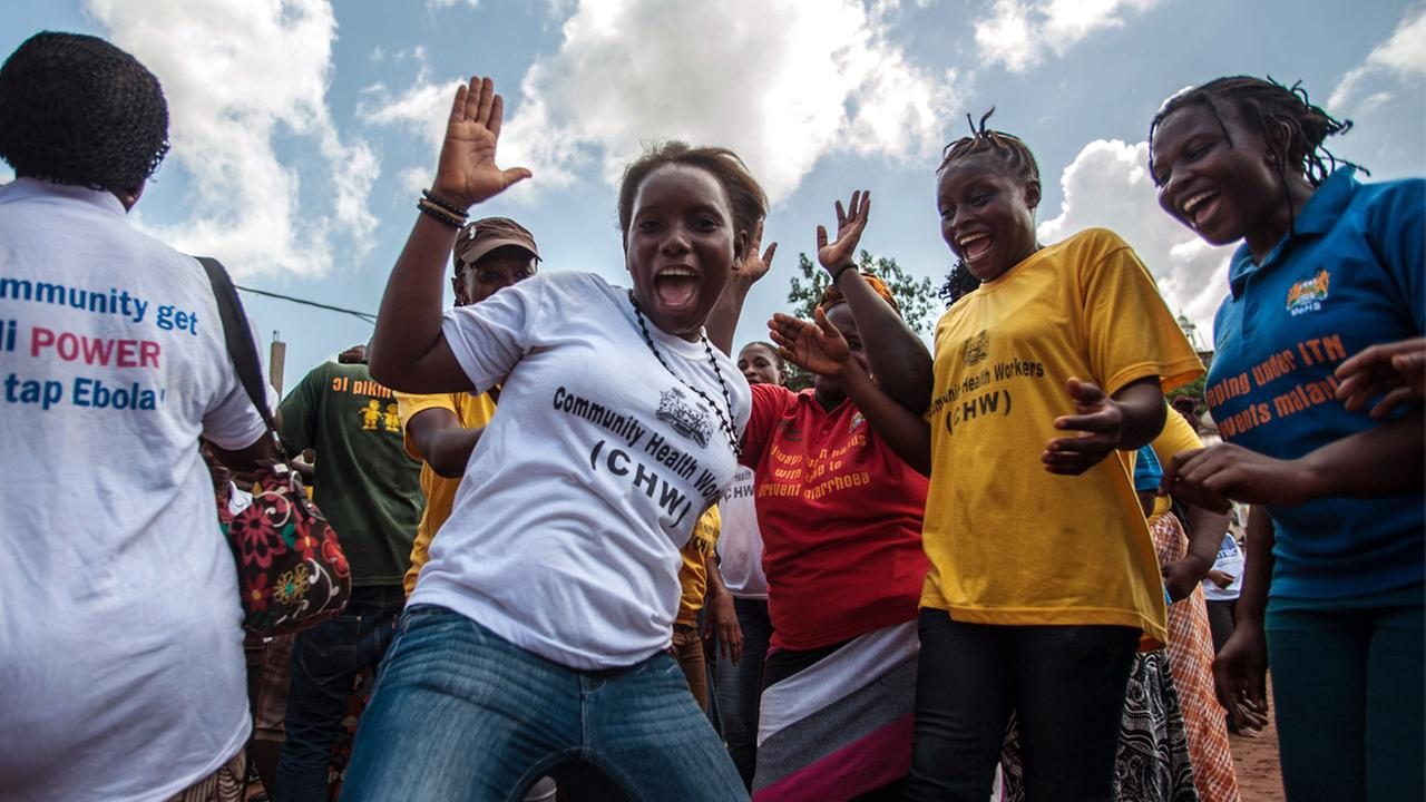 Women celebrate as their country is declared Ebola free in the city of Freetown Sierra Leone, Saturday, Nov. 7, 2015.