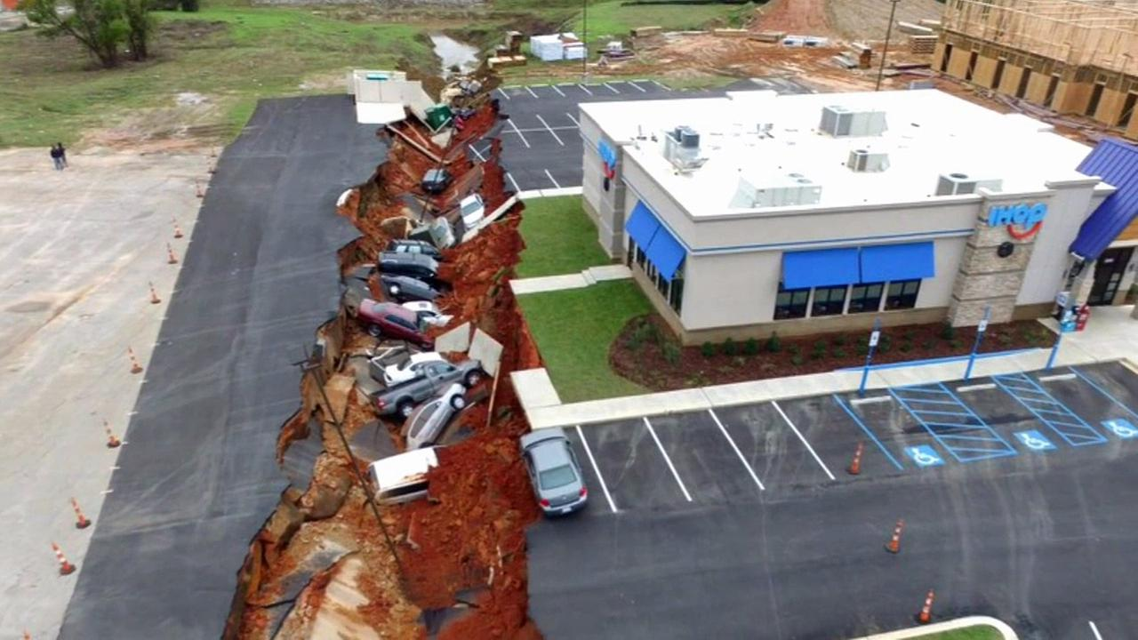 A dozen cars were swallowed up after a restaurant parking lot caved in on Saturday, Nov. 7 in Meridian, Mississippi.