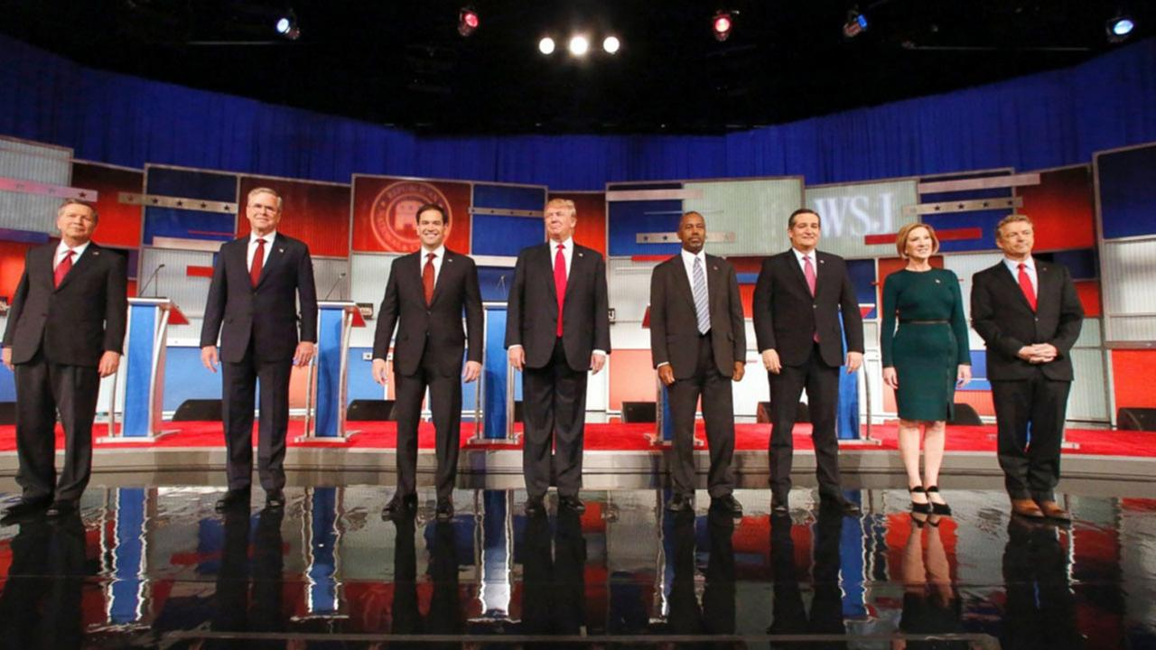 Republican presidential candidates John Kasich, Jeb Bush, Marco Rubio, Donald Trump, Ben Carson, Ted Cruz, Carly Fiorina and Rand Paul take the stage before the Republican presidential debate at the Milwaukee Theatre, Tuesday, Nov. 10, 2015, in Milwaukee.