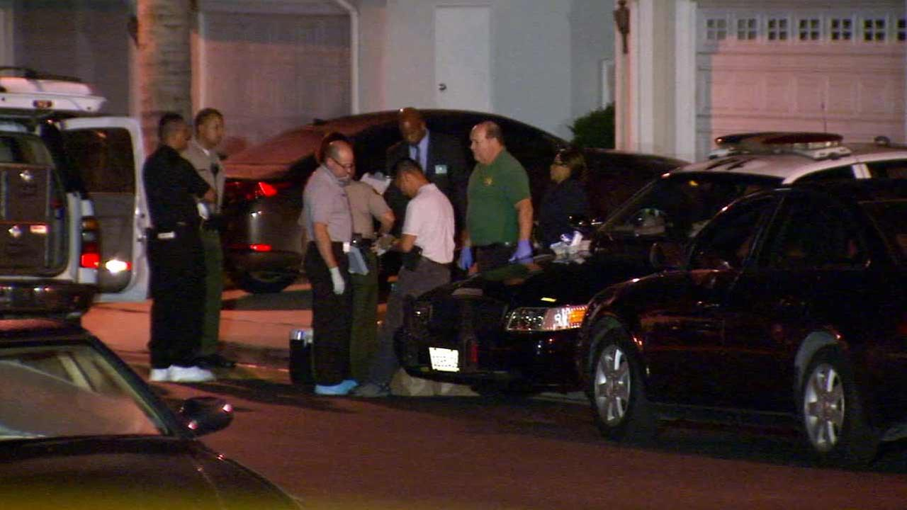 Los Angeles County sheriffs deputies conduct a homicide investigation in the 16600 block of Carriage Place in Hacienda Heights on Wednesday, Oct. 7, 2015.