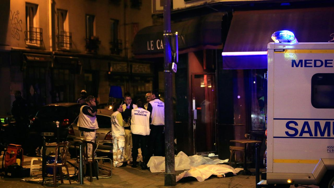 Medics stand by victims in a Paris restaurant, Friday, Nov. 13, 2015.AP Photo/Thibault Camus