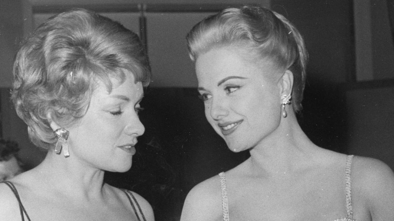 Oscar-nominated actress Martha Hyer (right), who starred alongside the likes of Frank Sinatra and Humphrey Bogart, died May 31, 2014, in Santa Fe, New Mexico. She was 89. <span class=meta>(AP Photo &#47; Heinrich Sanden Jr.)</span>